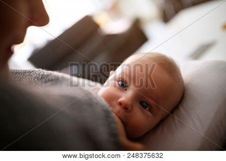 Cute little baby breastfeeding