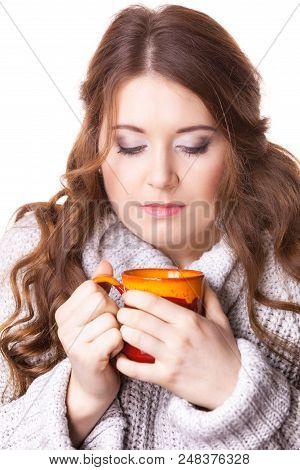 Woman Wearing Warm Clothing Grey Sweater Holding Nice Red Mug Of Warm Beverage Tea Or Coffee, On Whi