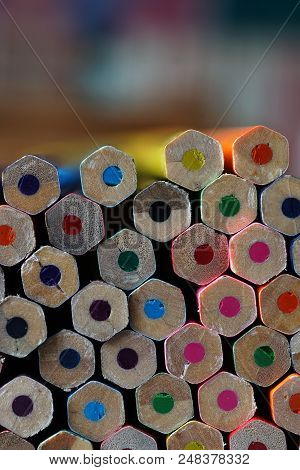 Bottom Of Multicolored Wooden Crayons In The Shape Of A Hexagon.  Stacked Color Pencils Close Up Wit