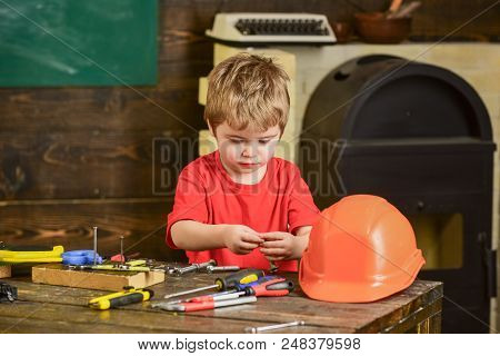 Informal Education Concept, Learning Through Game. Kid Playing With Working Tools. Boy Working With