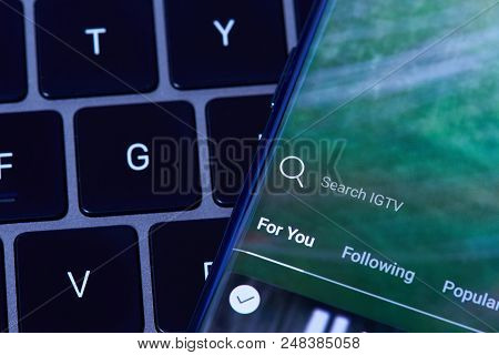 New York, Usa - July 6, 2018:igtv Search Menu    Menu On Smartphone Screen Lay On Laptop Keyboard