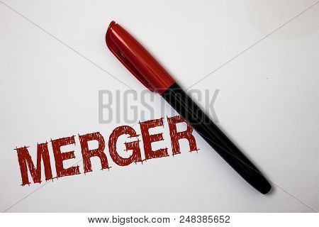 Writing Note Showing Merger. Business Photo Showcasing Combination Of Two Things Or Companies Fusion