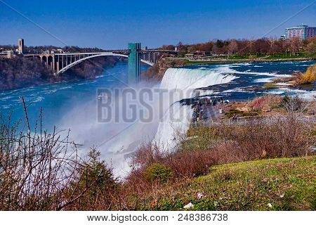 Niagara Falls Ny, Usa, 2018.05.08.; The American Fall And The Rainbow Bridge To Canada.