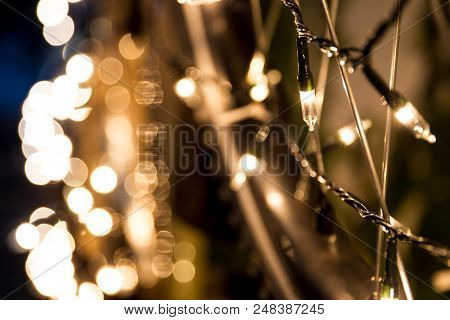 Decoration Light Bulb Hanging On Wall For The Christmas And New Year Celebrating.