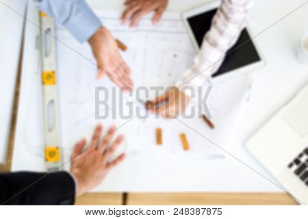 Blurred Background Of A Group Of Engineers Working.