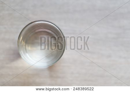 Top View Glass Of Water On Wood Table With Light In The Morning, Healthy Care Concept, Selective Foc