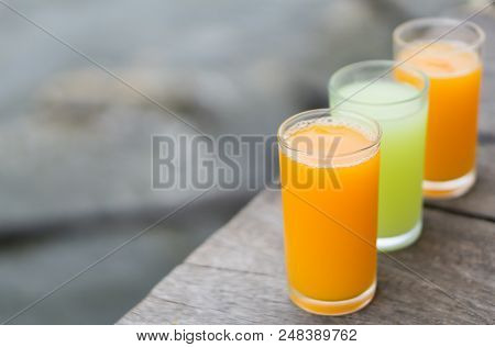 Closeup Orange And Guava Juice On Wood Background, Drink For Healthy Concept, Selective Focus