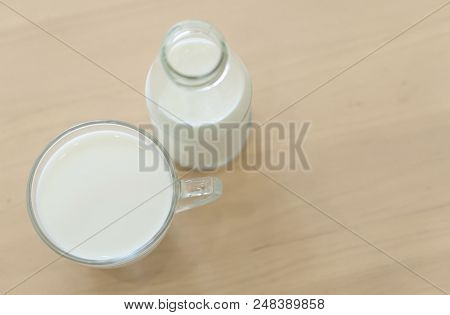 Closeup Top View Glass And Bottle Of Millk On Wood Table Background For Healthy Drink Concept, Selec