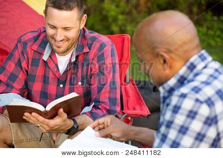 Men Having A Bible Study On A Camping Trip.