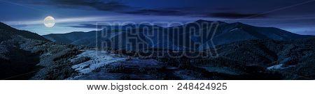 Beautiful Panorama Of Mountain Ridge At Night In Full Moon Light. Wonderful Landscape In Early Autum