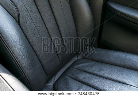 Modern Luxury Car Black Perforated Leather Interior. Part Of Leather Car Seat Details. Modern Car In
