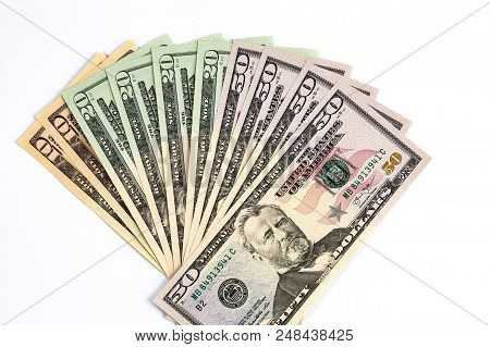 United States Dollars Arranged In Fan Shape On White Background. 50, 20, And 10 Dollar Bills