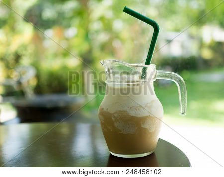 Glass Of Ice Coffee Frappe Drink On Wood Table In Sunshine Morning. Coffee Time For Relax.