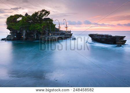 Pura Tanah Lot At Sunset, Famous Ocean Temple In Bali, Indonesia.