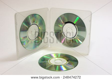 Double-sided Transflective White Case For Storing Mini Discs With Blank Cds On Clamps And Lying Next