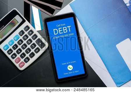 Top View Of Incoming Call On Smart Phone Screen From Creditor. Concept Of Business Financial And Deb