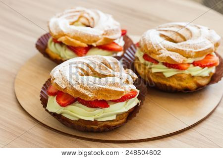 Paris Brest, Cream Puff Rings, Traditional French Choux Pastry. Summer Season Dessert With Pistachio