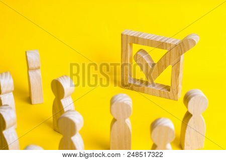 A group of wooden figures of people surround and look at a tick in the box. Voters take part in elections. Voting, referendum, social survey. Statistical data. Democratic process, institutions. poster