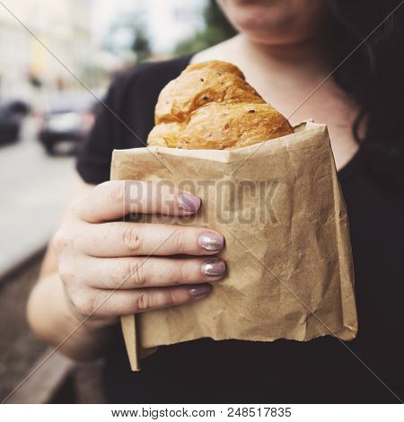 Snack On The Go, Junk Food, Unhealthy Lunch. Overweight Woman Eating Croissant At Cafe. Coffee Break