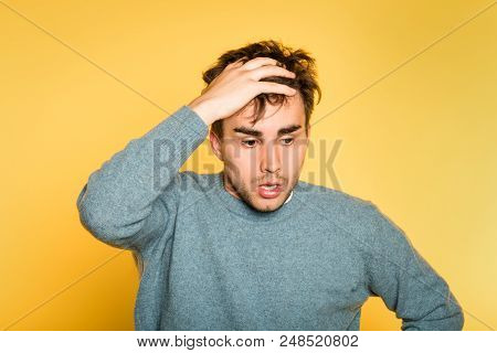 Sad Worried Distraught Scared Afraid Man Pulling Hair Out. Portrait Of A Young Handsome Brunet Guy O