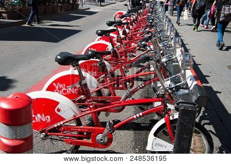 Barcelona, Spain - March 30, 2016: Bicycles For Rent. Viu Bicing Bikes. Public Transport Of Bicycle.