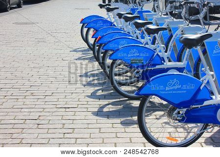 St. Petersburg, Russia - June 25, 2018: Bike Rent Outdoors. New Blue Bikes Lined Up In Row At Rental