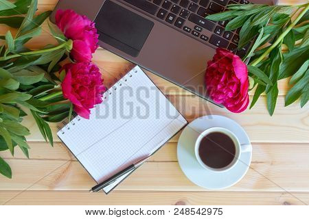 Coffee Cup, Laptop Keyboard, Empty Notebook And Red Peony Flowers On Wooden Table. Top View, Copy Sp