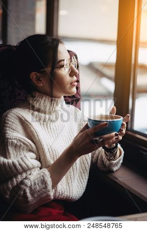 Girl Enjoying Flavor Of Coffee While Relaxing At Coffee Shop At Daylight