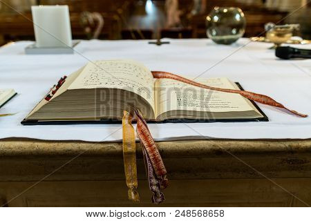Koblenz, Germany, 15.06.2018 - Praying Book On The Altar In A Church Before A Wedding Focused On The