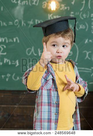 Idea Concept. Little Child Got Idea. Boy In Graduation Cap With Raised Finger Show New Idea. Bingo.