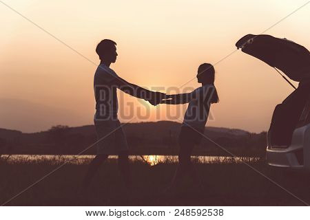 Silhouette Couple Lover In Romantic Of Fascinate On The Beach At Sunset