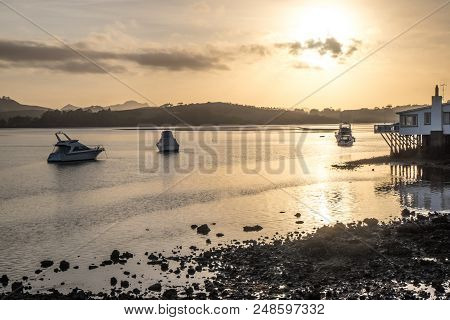 Daybreak - Dawn With Boats And Rocks At Mangonui Harbour, Far North District, Northland, New Zealand