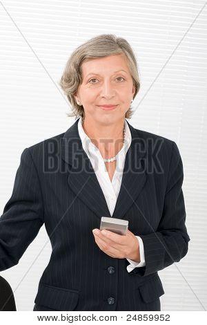 Senior Businesswoman Smile Hold Cellphone