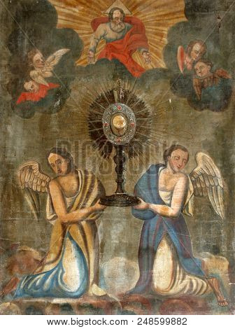 SVETICE, CROATIA - JULY 02: Eucharistic adoration monstrance with the Blessed Sacrament, with angels, altarpiece in Church of Birth of Virgin Mary in Svetice, Croatia on July 02, 2016.