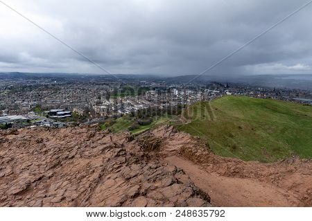 View Of Edinburgh City From Arthur's Seat, The Highest Point In Edinburgh Located At Holyrood Park,