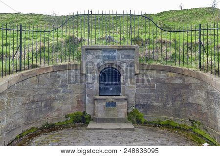 The Remain Of The Ancient Well House Located At The Foothill Of Holyrood Park In Edinburgh, Scotland