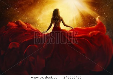 Fashion Model Back Side In Red Flying Dress, Woman Rear View, Gown Fabric Fly On Wind, Beautiful Gir