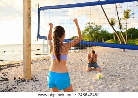 Beach volley ball fun. Girl winning game, man crying. Friends playing beach volleyball sport. Woman living healthy active sport lifestyle. Recreational outdoor game in summer.