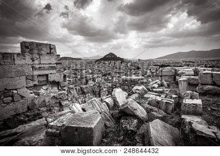 Panoramic View Of Athens With Mount Lycabettus From The Acropolis, Greece. Ancient Greek Ruins On Th