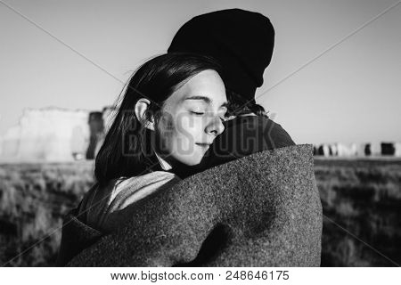 Couple hugging  in the wilderness