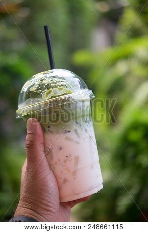Ice Milk Green Tea In Plastic Glass. Concept Is Easy Beverage For Traveler