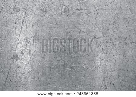 Worn Steel Sheet Background, Light Metal Texture With Scratches And Dents