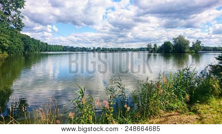Scenic View Of Pond Against Dramatic Sky With Clouds In South Bohemia, Near Trebon City. One Of The
