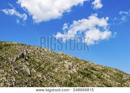 Blue Sky And Fluffy White Clouds Over The Karst Ridge Of Chepan Mountain At Dragoman Marsh In Sofia
