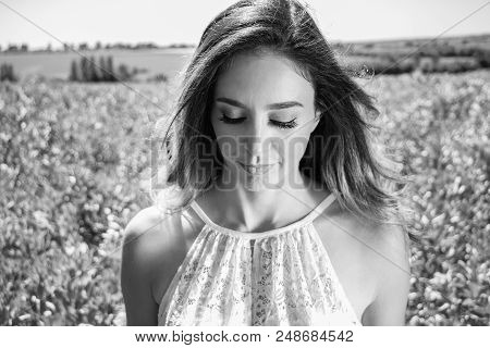 Beautiful Woman, Bride Walks Through Crop Field On A Sunny Summer's Day