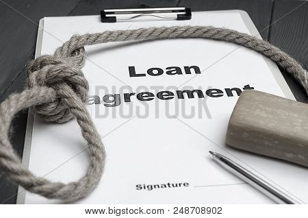 The Concept Of Lending And The Severity Of Loan Repayment. Loan Agreement, A Loop, Soap, A Pen