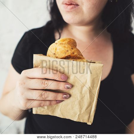Snack On The Go, Junk Food, Unhealthy Lunch, Dieting. Overweight Woman Hesitating To Eat Croissant
