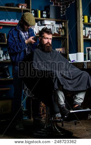 Barber With Clipper Trimming Hair On Nape Of Client. Hipster Client Getting Haircut. Hipster Hairsty