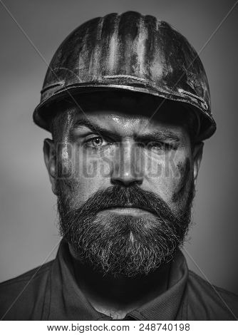 Man builder. Business, building concept - serious builder in hardhat. Engineers working. Building, construction, industry&people concept - bearded builder, architect, contractor, engineer. Black&white poster