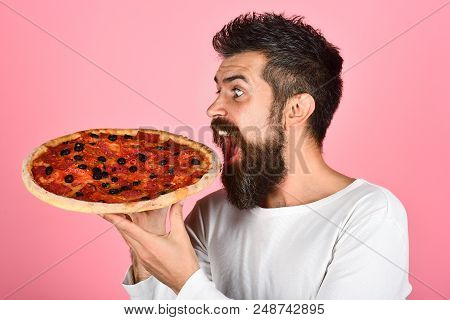 Man Eating Pizza. Bearded Man Hipster With Pizza. Food, Lunch And People Concept - Happy Hungry Man